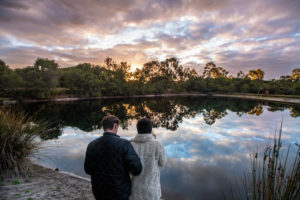 Couple standing near lake