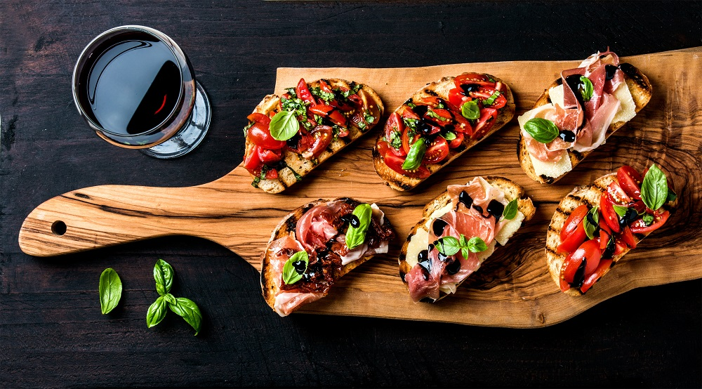 Brushetta set and glass of red wine