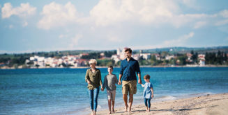 family walking together along the shore