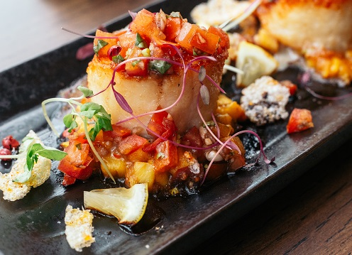 Enjoy grilled scallops